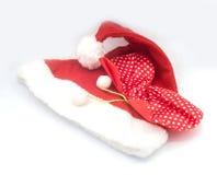 Weihnachtsmann-Hut auf dem weißen Hintergrund, Weihnachtsmann Stockfotos
