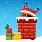 Weihnachtsmann im Kamin Stockbild