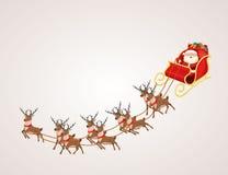 Weihnachtsmann im Ren-Pferdeschlitten Lizenzfreies Stockfoto