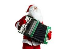 Weihnachtsmann mit accordian Stockfoto