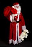 Weihnachtsmann mit einem Beutel Lizenzfreie Stockfotografie