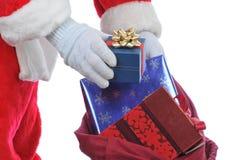 Weihnachtsmann mit einem Beutel der Geschenke Lizenzfreie Stockfotos