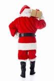 Weihnachtsmann mit einem Geschenk Lizenzfreies Stockbild