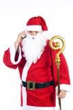 Weihnachtsmann mit einem Mobiltelefon Lizenzfreie Stockbilder