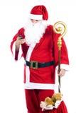Weihnachtsmann mit einem Mobiltelefon Stockfotos
