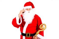 Weihnachtsmann mit einem Mobiltelefon Stockfotografie