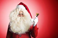 Weihnachtsmann mit einer Glocke Stockbilder