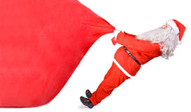 Weihnachtsmann mit einer großen Tasche Stockbild