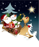 Weihnachtsmann mit Freunden Stockfotos