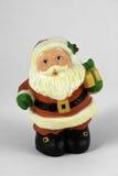 Weihnachtsmann mit Geschenk Stockfotos