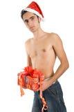 Weihnachtsmann mit Geschenk. Stockfotografie
