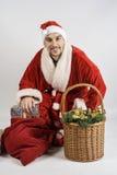 Weihnachtsmann mit Geschenken Stockfotos