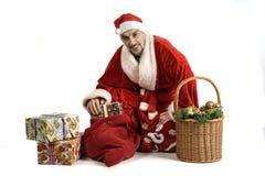 Weihnachtsmann mit Geschenken Stockbilder