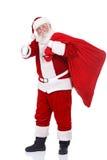 Weihnachtsmann mit großem Beutel lizenzfreies stockbild