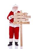 Weihnachtsmann mit hölzernem singen Stockbild