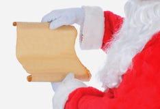 Weihnachtsmann mit Liste Stockfotografie