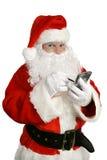 Weihnachtsmann mit Personal-Computer Stockbild