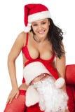 Weihnachtsmann mit reizvollem Mädchen Lizenzfreie Stockbilder