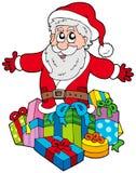 Weihnachtsmann mit Stapel der Geschenke Stockbilder