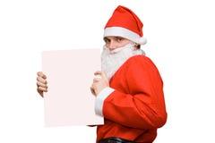 Weihnachtsmann mit unbelegter Karte Stockfotografie