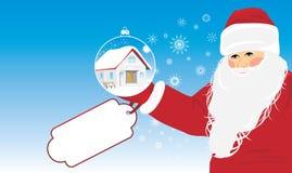 Weihnachtsmann mit Weihnachtsgeschenk in der Hand Lizenzfreies Stockfoto