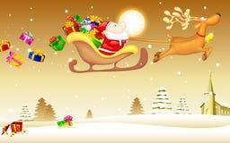Weihnachtsmann mit Weihnachtsgeschenk im Schlitten Stockbild