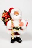Weihnachtsmann mit Weihnachtsgeschenken Lizenzfreie Stockfotografie