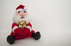 Weihnachtsmann-Spielzeug auf weißem Hintergrund Lizenzfreies Stockfoto