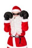 Weihnachtsmann-tragende Sonnenbrillen mit Verpackenhandschuh Stockbild