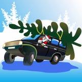 Weihnachtsmann treibt Weihnachtsbaum an. Lizenzfreies Stockfoto