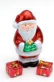 Weihnachtsmann und Geschenke Stockfoto