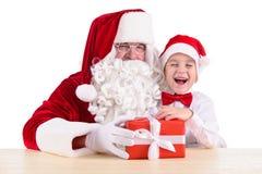 Weihnachtsmann und Kind Stockfoto
