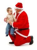 Weihnachtsmann und kleiner Junge lizenzfreie stockfotos