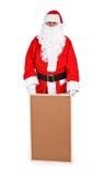 Weihnachtsmann und leeres Anschlagbrett Stockfotos