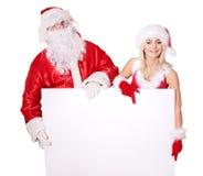 Weihnachtsmann-und Mädchenholdingfahne. Stockfoto