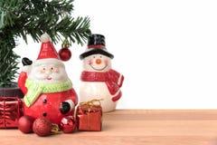 Weihnachtsmann und Schneemann mit dem Geschenk- und Weihnachtsbaum Lizenzfreies Stockfoto