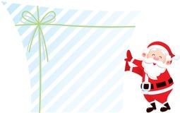 Weihnachtsmann und sein Geschenk Stockfoto