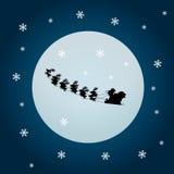 Weihnachtsmann und Zügel deers mit Mond Lizenzfreie Stockbilder