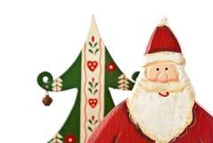 Weihnachtsmann vor Weihnachtstanne 2. Stockfoto