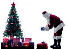 Weihnachtsmann-Weihnachtsbaumschattenbild lokalisiert Stockbilder