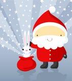 Weihnachtsmann zeigt magische Tricks mit Kaninchen Stockbild