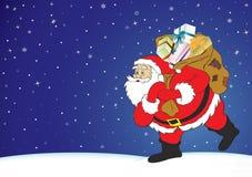 Weihnachtsnacht, Weihnachtsmann mit Geschenken Stockfotografie