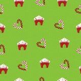 Weihnachtsnahtloses Muster Lutscher und Lebkuchenhäuser auf einem grünen Hintergrund Lizenzfreie Stockfotografie
