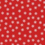Weihnachtsnahtloses Muster von den weißen Schneeflocken auf rotem Hintergrund Lizenzfreie Stockbilder