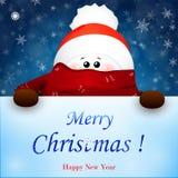 Weihnachtsnetter Schneemann mit Schal- und Rotweihnachtsmann-Hut Stockbild