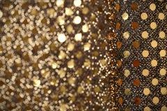 Weihnachtsneues Jahr-Goldfunkelnhintergrund Abstraktes Beschaffenheitsgewebe des Feiertags Lizenzfreie Stockfotos