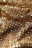 Weihnachtsneues Jahr-Goldfunkelnhintergrund Abstraktes Beschaffenheitsgewebe des Feiertags Stockbild