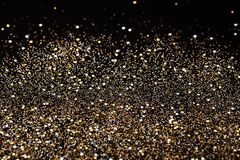 Weihnachtsneues Jahr-Schwarzes und Goldfunkelnhintergrund Abstraktes Beschaffenheitsgewebe des Feiertags Lizenzfreies Stockfoto