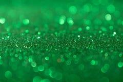 Weihnachtsneues Jahr-Valentine Day Green Glitter-Hintergrund Abstraktes Beschaffenheitsgewebe des Feiertags Element, Blitz lizenzfreies stockbild