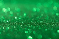 Weihnachtsneues Jahr-Valentine Day Green Glitter-Hintergrund Abstraktes Beschaffenheitsgewebe des Feiertags Element, Blitz stockfoto